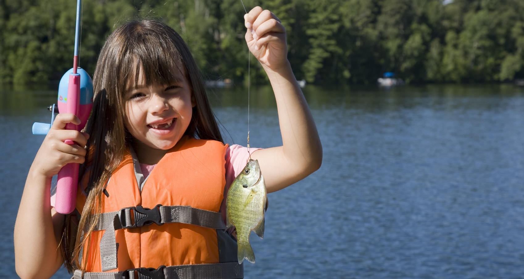 girl holding her fishing catch on Lake Simcoe in Georgina
