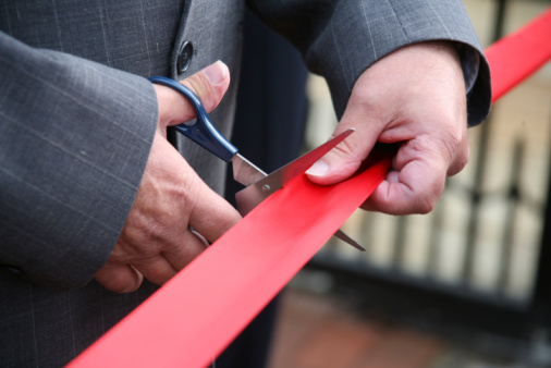 Close up of a ribbon being cut