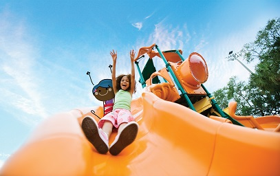 Girl on orange slide